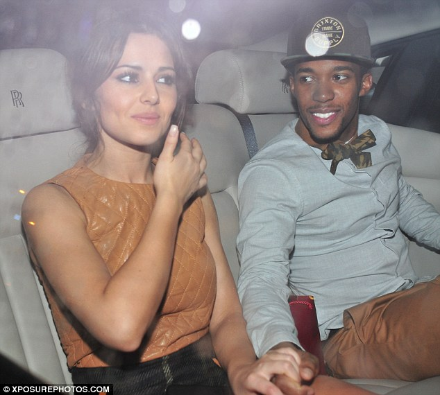 Moving on: Cheryl is now in a happy relationship with dancer Tre Holloway