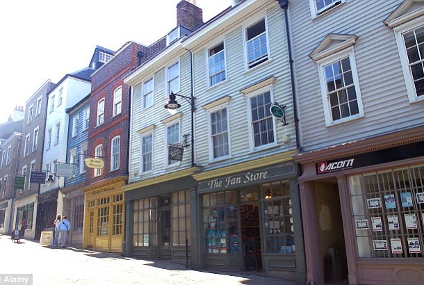 On the surface: Osolase was a recycling worker living in a terraced house in Gravesend (High Street pictured)