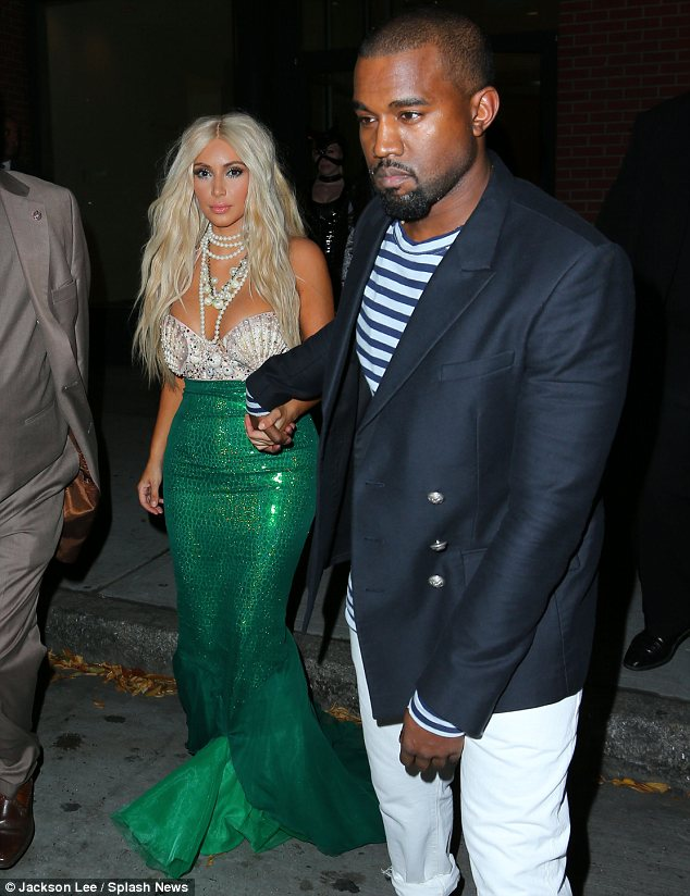 Hand in hand: Kim may have steered clear of a spooky outfit but Kanye didn't seem to mind