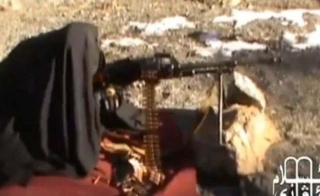 Deadly: One woman uses a large rock to keep her weapon steady as she learns how to fire it