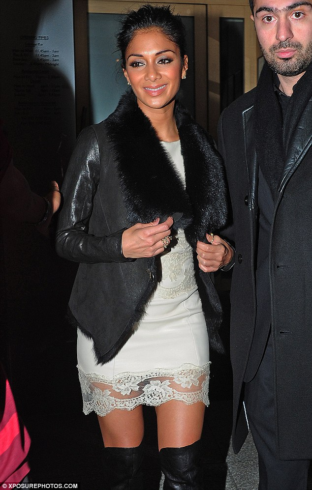 Rare misstep: She is often sporting a sleek and stylish look, but Nicole Scherzinger had a bad hair day on Sunday night