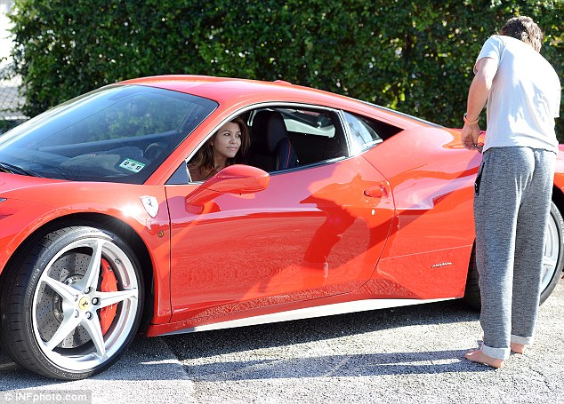 Inspection: Scott let Kourtney take the wheel as he inspected the exterior of the vehicle