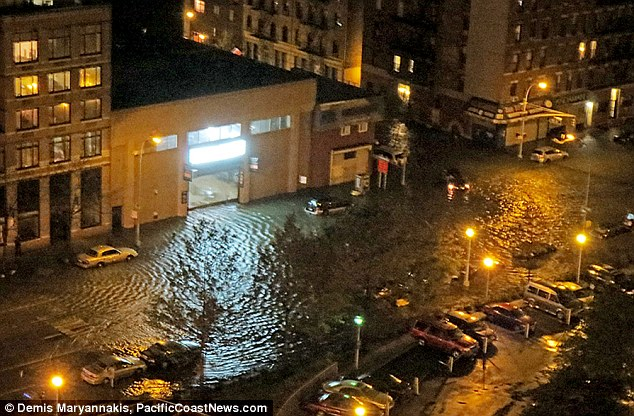 Flooded: Sandy hit New York on Monday evening as subways and road tunnels were flooded after a 13ft wall of wall poured into the city