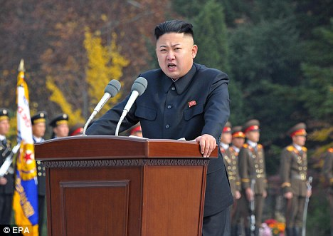Monuments: Kim Jong-un giving a speech during a ceremony to unveil statues of his grandfather Kim Il-sung and his father Kim Jong-il (below)