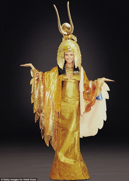 Golden goddess: Both beauties opted for ornate collars and golden snake-headed headdresses - though Heidi's two-foot design wins for height alone