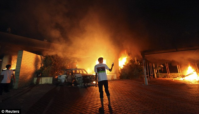 Attack: The US Consulate in Benghazi is seen in flames during fierce clashes in which US Ambassador Chris Stevens died