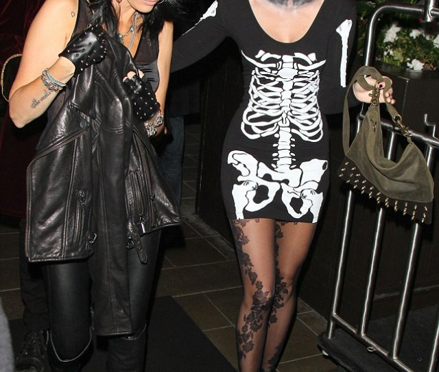 White Face Paint Scary Star Miley Cyrus Dressed Up In A Saucy Skeleton Costume For A Halloween Party