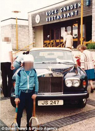 Family holiday: The young boy pictured posing next to Jimmy Savile's Rolls-Royce claims he was later abused by the TV star