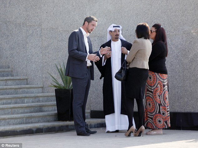Facing jail: Ms Blake (second right) and Mr McRedmond (left) chat with their lawyer Shaker Al Shammary (second left) and Ms Blake's sister Natasha Todd (far right) outside the Dubai Courts ahead their hearing today