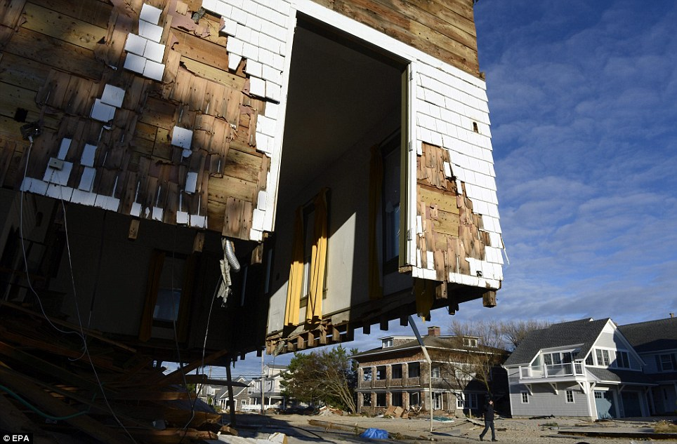 Floorless: A waterfront home in Bay Head, New Jersey, is missing part of its foundations after Sandy barrelled in