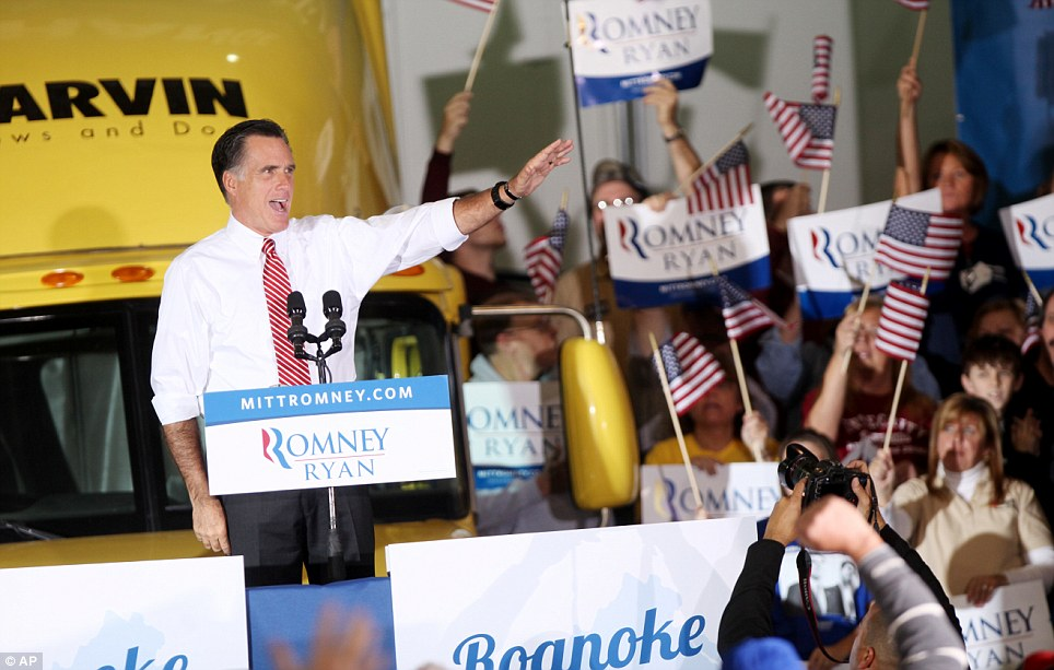 Reaching out: Republican presidential candidate Mitt Romney greets supporters at a campaign event at a window and door factory in Roanoke, Virginia