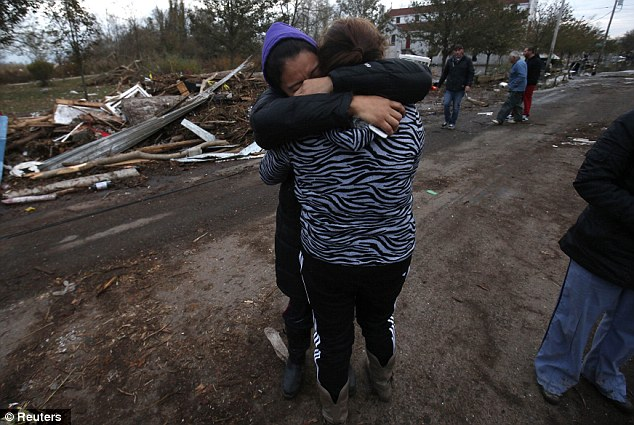 The other side: Dulce Espino (left) and Viridiana Cruz weep in their Staten Island neighborhood where many houses were completely destroyed
