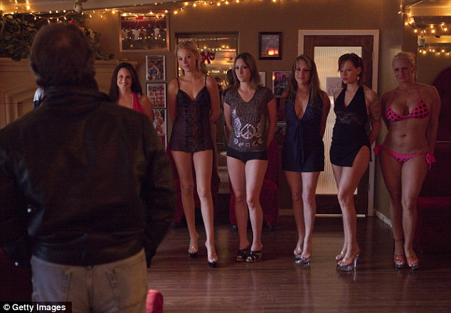 Legal: Prostitutes line up to be chosen from in a Nevada brothel