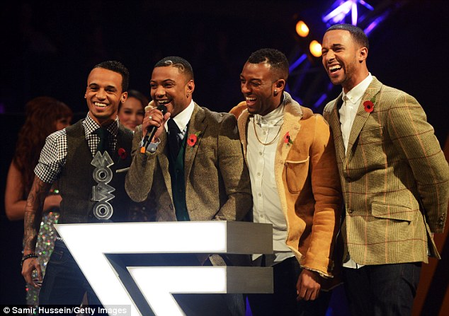 Smiling lads: JLS took to the stage to pick up the gong for Best Video and seemed pretty pleased about it
