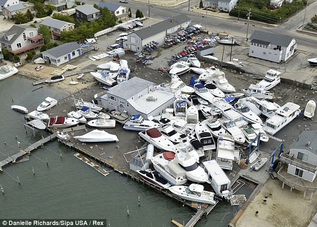 Stacked: Boats piled up on top of one another near Beach Haven Inlet on the New Jersey coastline. Residents outside of New York City believe they are being passed over while aid is directed to Manhattan