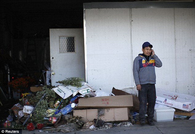 Reception: A man makes a phone call next to discarded storm garbage in Coney Island Friday