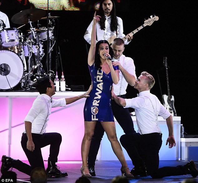 Rallying support: Katy Perry wore an unforgettable dress to a campaign rally for President Barack Obama on Saturday in Milwaukee, Wisconsin