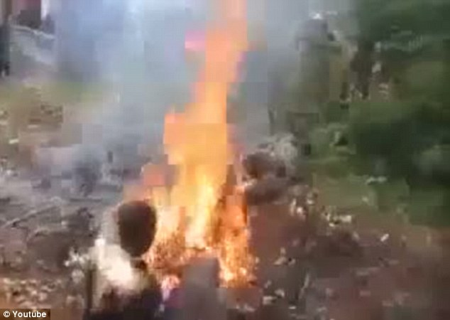 Extraordinary images: Three years ago uproar was caused after a video emerged on the internet showing five people burned in the village of Nyamataro, Kisii, in the east of Kenya, over witchcraft allegations