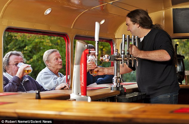 The lower deck of the 1966 red Routemaster has been converted into a fully functional bar - complete with beer pumps