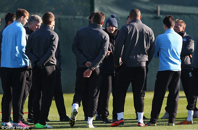 Guidance: Mancini (centre, in the hat) talks tactics to his players