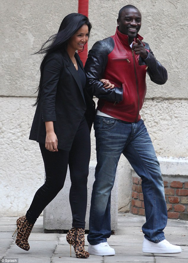 Happy go lucky: Akon appeared to be in a great mood and laughed when he spotted a photographer