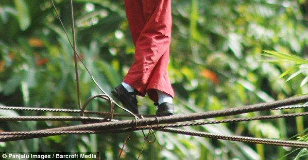 The children risk a 30 foot drop as they cross the river each morning before school