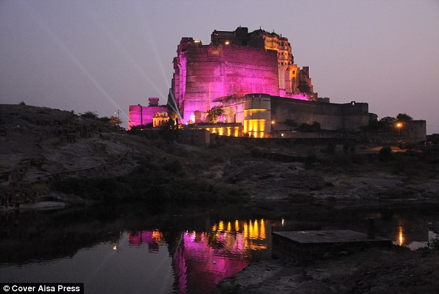 All lit up: The fort is lit in pink and yellow in a test run before Wednesday's party