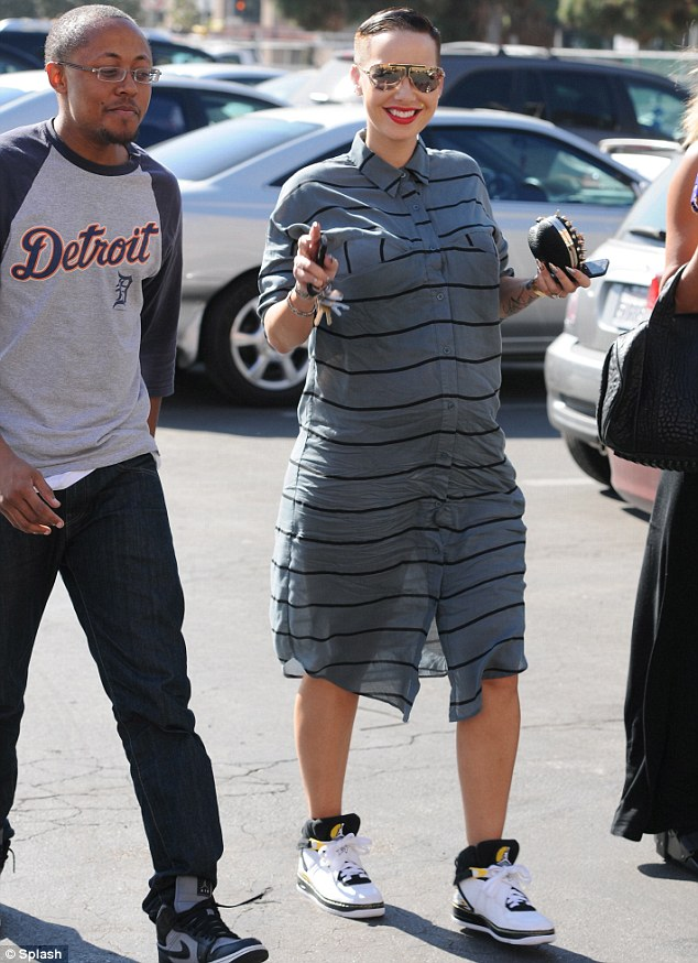 Misfire: Pregnant Amber Rose stepped out in this odd-looking Long John-inspired dress on Tuesday