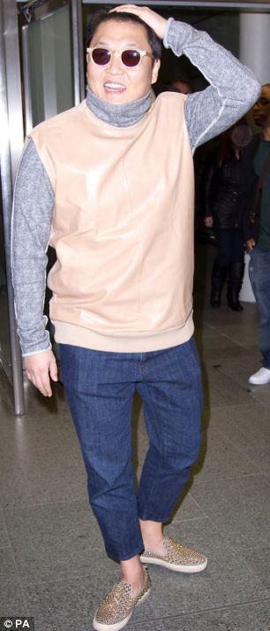 Psy arrives at St Pancras station