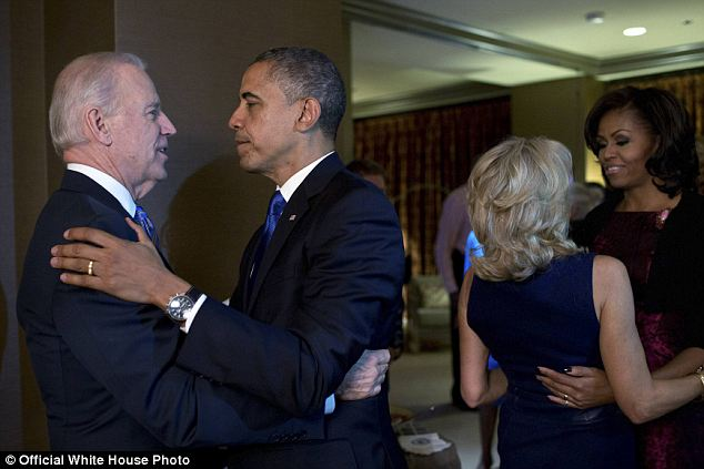 Running mates: President Obama and Michelle hug Vice President Joe Biden and his wife Dr. Jill Biden just moments after the television networks call the election for the President