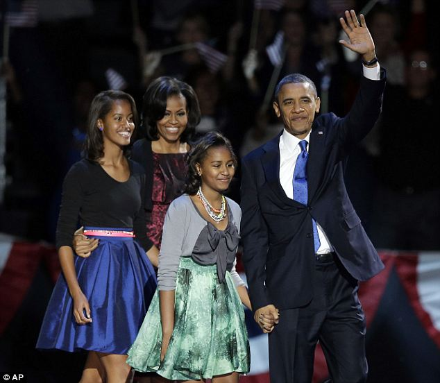 First family second time around: The Obamas walk onto the stage in Chicago shortly before the President gave his acceptance speech