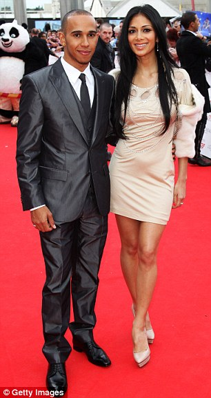 Celebrity couple: Nicole, pictured with boyfriend Lewis Hamilton, said she preferred the spotlight to be on Kanye West and Kim Kardashian