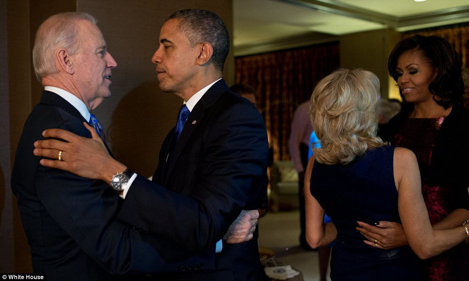 Yes we could: Barack Obama and Joe Biden congratulate each other with their wives in Chicago