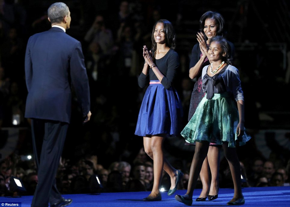 Pride: The whole Obama family congratulated the President after his landslide election