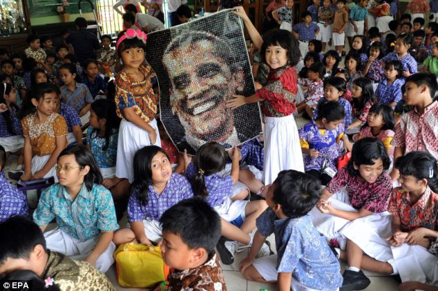 Young support: Indonesian elementary students at Menteng 01 elementary school, where the US President Barack Obama studied, hold a picture of US President Obama