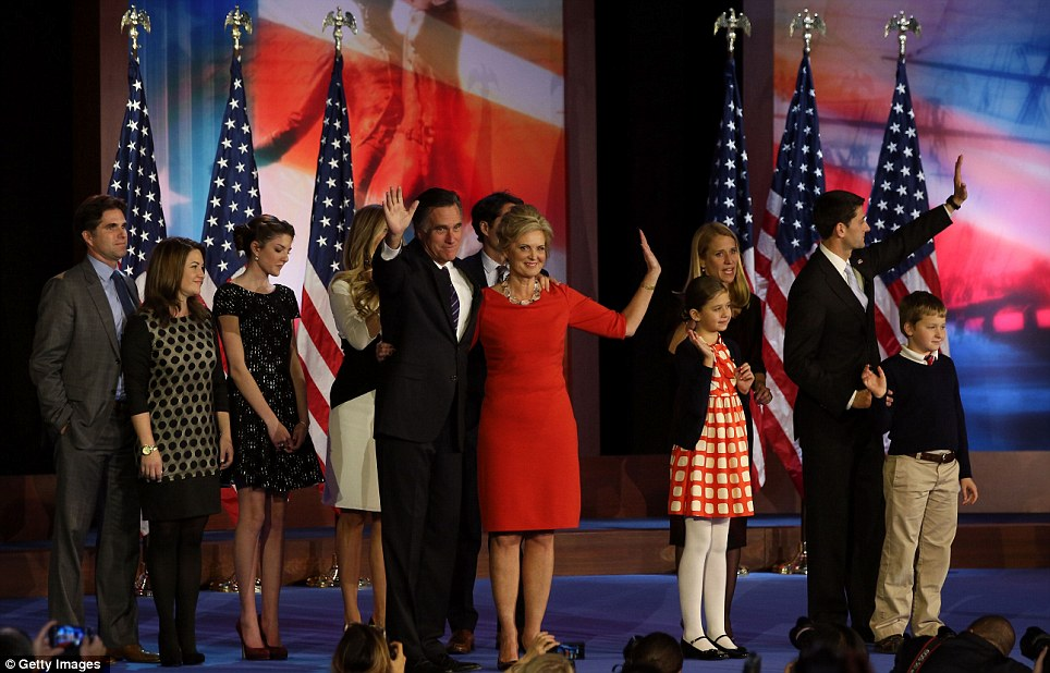 Republican presidential candidate, Mitt Romney with his wife Ann and the rest of his family crowd onto the stage after conceding defeat.