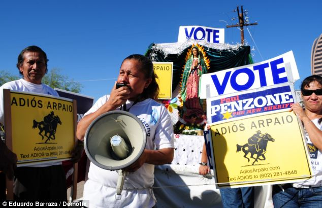Speaking out: Voters in Phoenix rally to promote the Latino vote and encourage people to back Maricopa County Sheriff candidate Paul Penzone on Tuesday