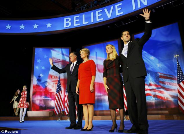 Thankful: Romney waves with his wife Ann with vice presidential nominee Paul Ryan and his wife Janna