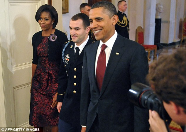 Style savvy: Mrs Obama wearing the same Michael Kors dress at a Medal of Honor presentation ceremony on November 16, 2010, at the White House