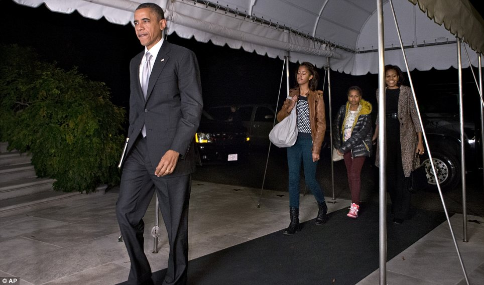 Not getting evicted: The First Family re-entered the house via a specially constructed walkway