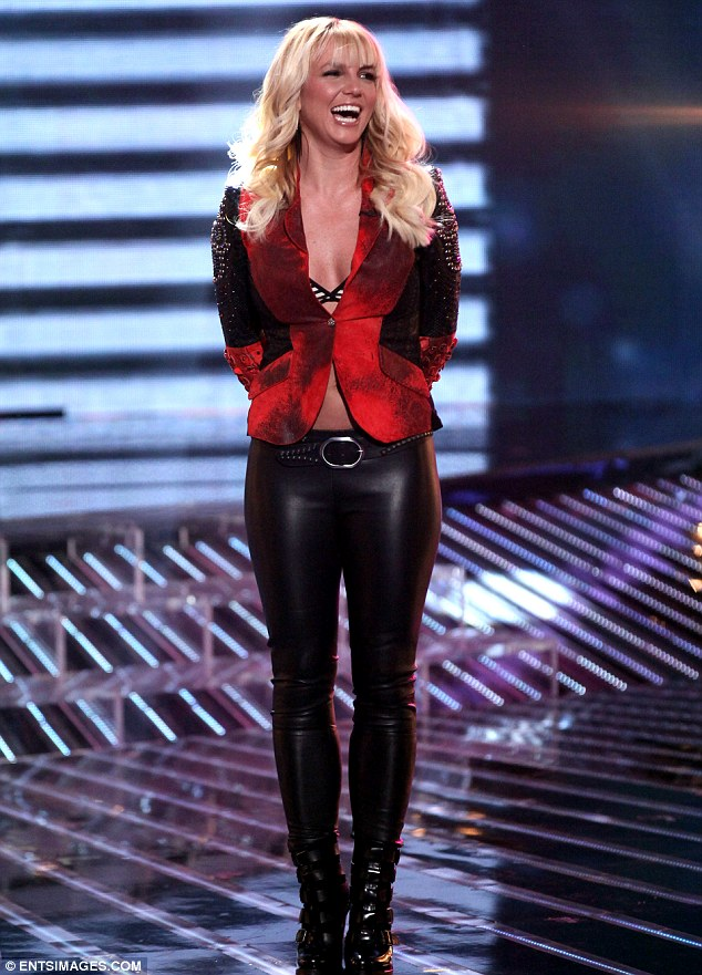 She works out: Britney Spears wore leather trousers as she appeared on the X Factor USA on Wednesday night, as Khloe Kardashian wore the same material