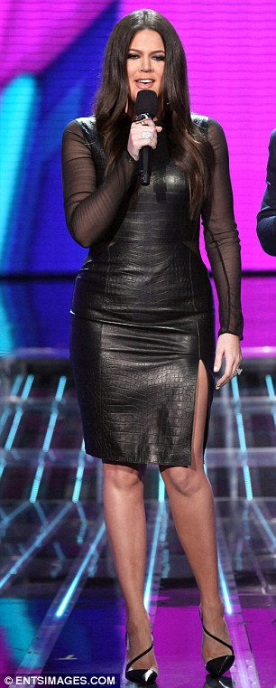 Fashion fight: While Britney showed off her toned thighs in tight trousers, Khloe covered her curves in a dress