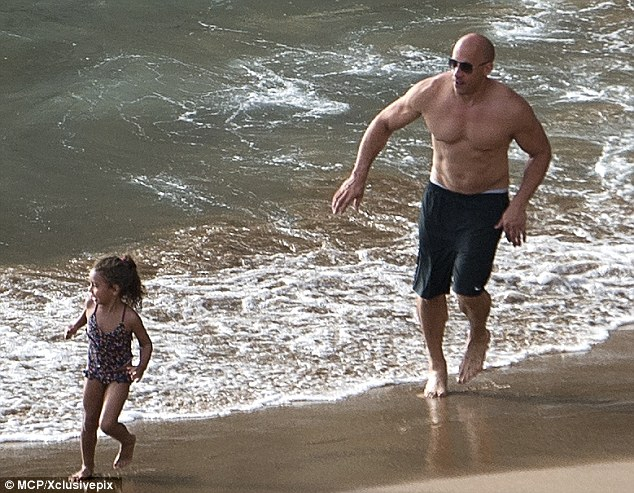 Too fast and too cute: Vin Diesel chased after his daughter Hania while on holiday in the Canary Islands