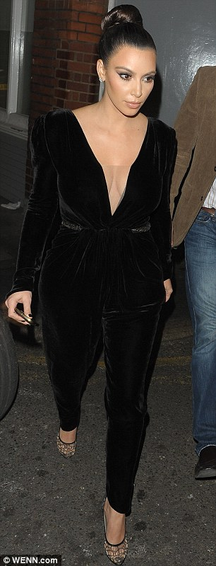 Kanye must approve: The rapper no doubt loved the plunging neckline on her black velvet jumpsuit