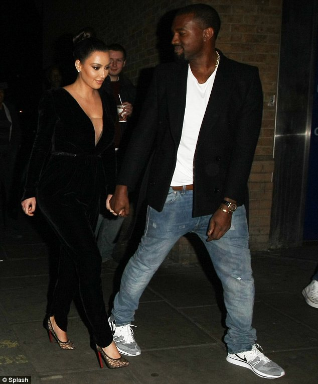 The apple of my eye: It's hardly a surprise Kanye couldn't stop staring at Kim in her arresting ensemble