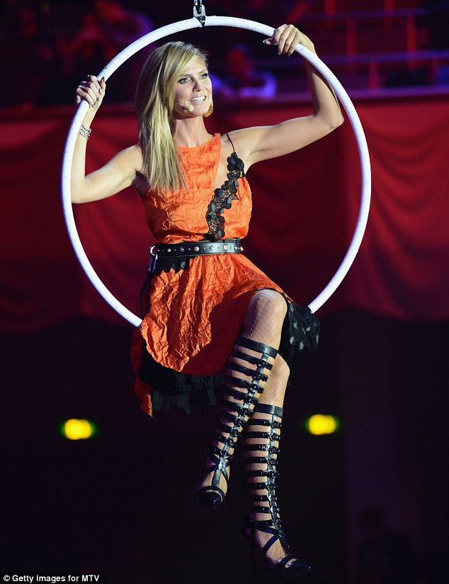 She's on fire: Heidi wore a series of very different gowns to host the MTV EMAs