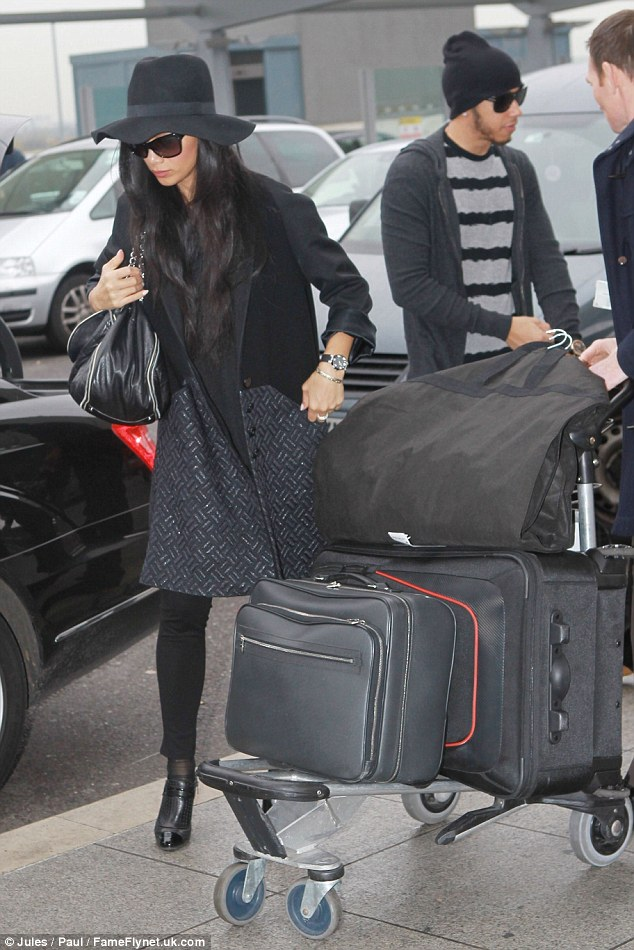 Loaded up: The pair looked like they'd packed for a while despite Nicole being due back on The X Factor on Saturday