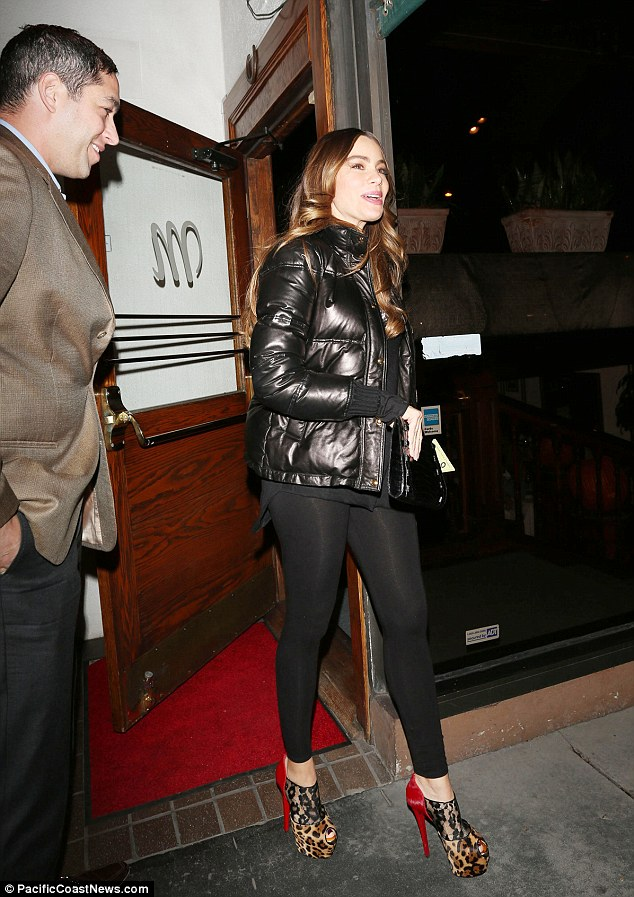 Romantic date night: Sofia stepped out in the expensive footwear with her beaming boyfriend in tow