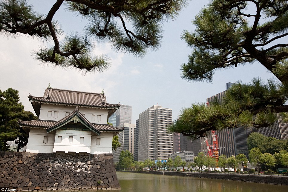 The past and the present: The Imperial Palace is now surrounded by modern skyscrapers in Tokyo