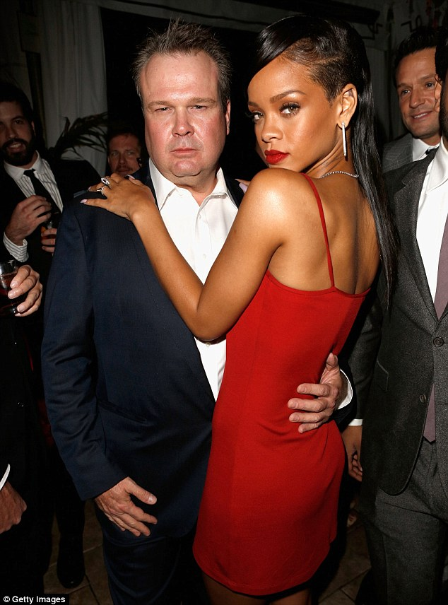 Blue steel: Rihanna cosies up to Modern Family star Eric Stonestreet